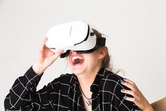 Enjoying a funny virtual reality experience Kuvituskuvat