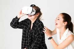 Laughing, having fun and enjoying virtual reality experience Kuvituskuvat