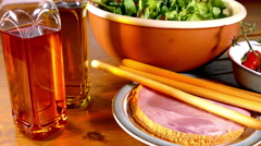 Bottles of oil next to a ham salad. Stock Footage