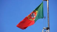 Portugal flag against a sky Stock Footage
