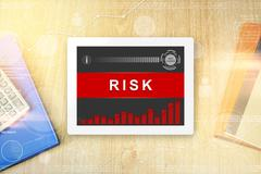 Risk word on tablet Stock Photos