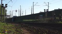 People pass railway crossing Stock Footage