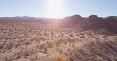 Aerial of dry grass on desert land Stock Footage