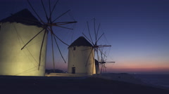 Sunset close up of the old windmills on the island of mykonos, greece Stock Footage
