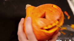 Jack-o'-lantern Halloween symbol pumpkin carving Stock Footage