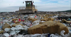 Bulldozer flattening landfill Stock Footage