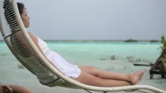 Woman on hammock enjoying the horizon Stock Footage