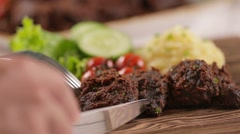 Eating rendang jerky beef stew cutlet on a cutting board Stock Footage