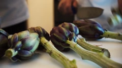 Cutting artichokes Stock Footage