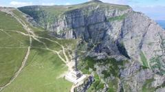 Heroes Cross on Caraiman Peak, aerial view, Romania Stock Footage