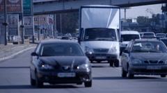 City urban road traffic HD video. Cars rides past camera Kyiv, Ukraine Stock Footage