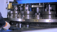 An industrial serviceman repairing, labouring at a cnc industrial machine Stock Footage