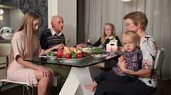 Family praying before thanksgiving meal Stock Footage