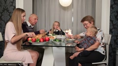 Happy family eating traditional Thanksgiving food Stock Footage