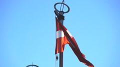 Latvia flag against a sky Stock Footage
