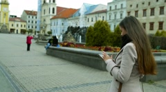 Woman with tablet walking outdoors in old town Stock Footage