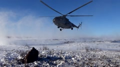 Landing a helicopter on the tundra Stock Footage