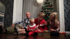 Grandparents with children celebrating Christmas Stock Footage
