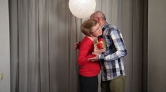 Senior man giving valentine's gift to his wife Stock Footage