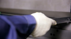 Worker hands bend metal sheet on a modern bending industrial machine at a Stock Footage