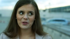 Face of beautiful young woman in the city Stock Footage