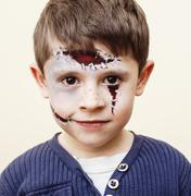 Little cute boy with facepaint like zombie apocalypse at hallowe Stock Photos