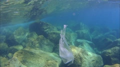Plasticbag floating under water Stock Footage