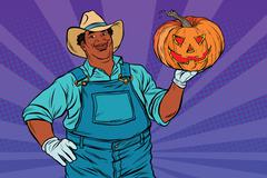 African American farmer with a Halloween pumpkin Piirros