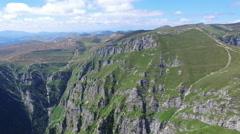 Caraiman Peak, Romania, aerial flight Stock Footage