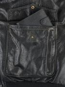 Black purse in a pocket of leather jacket Stock Photos