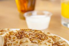 Close up of a fresh golden crumpet on a breakfast table Stock Photos