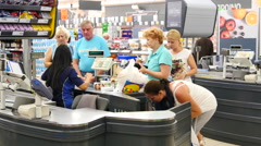 Customers paying for shopping at a supermarket. Line at the cash Stock Footage