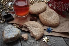 Christmas tea with cookies, Christmas toys and sweets Stock Photos