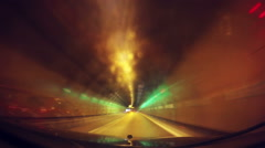 Speeding car through tunnel, vehicle dashboard driving plate pov Stock Footage