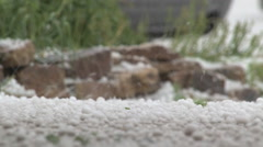 Hail storm at ground level - close up Stock Footage