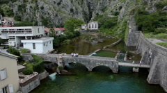 One of the entrances of medieval fortress of Kotor. Bridge is across river Stock Footage