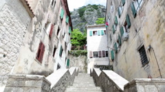 Stone staircase leads to entrances of living houses in old town of Kotor Stock Footage