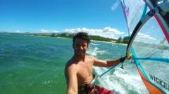 POV Windsurfer Gliding Across Blue Ocean Stock Footage
