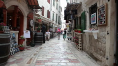 Cafes, restaurants and giftshops are in narrow streets of old town of Kotor Stock Footage