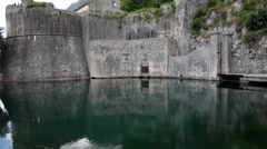 Walls and bartisan towers of medieval fortress of Kotor city. Montenegro Stock Footage