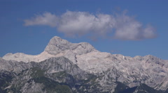 Time lapse footage of cloud forming over Triglav mountain peak Stock Footage
