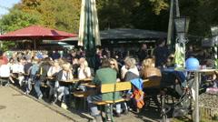 4K German people enjoying eating drinking beer garden Olympia Park Munich Stock Footage