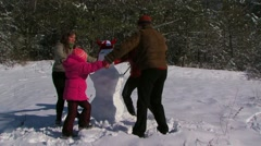 Family Playing in Winter Snow Stock Footage
