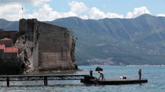 Sea pier for ships is in beach Ricardova Glava near medieval fortress. Adriatic  Stock Footage