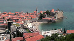 Beautiful old walled fort of Budva city with sandy beach Ricardova Glava Stock Footage
