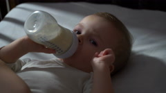 Footage baby eating baby food from a bottle. 4k Stock Footage