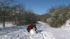 Girl Sculpt Snowman Stock Footage