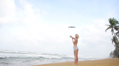 Young woman with a slender figure is engaged in gymnastics at sea Stock Footage