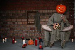 Pumpkin head monster horror indoor Stock Photos