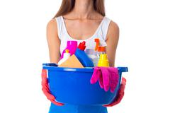 Woman holding cleaning things in washbowl Stock Photos
